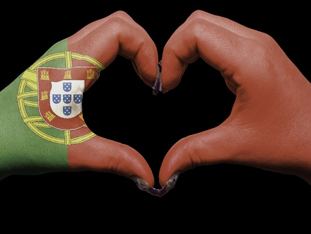 Gesture made by portugal flag colored hands showing symbol of heart and love