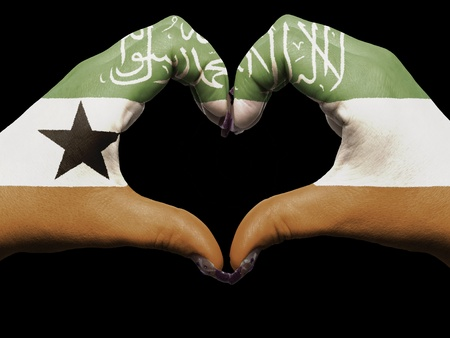 Gesture made by somaliland flag colored hands showing symbol of heart and love Stock Photo - 12981814