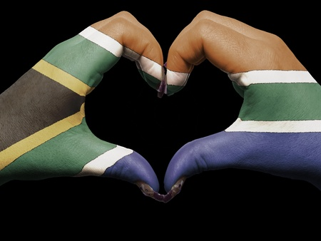 Gesture made by south africa flag colored hands showing symbol of heart and love  photo
