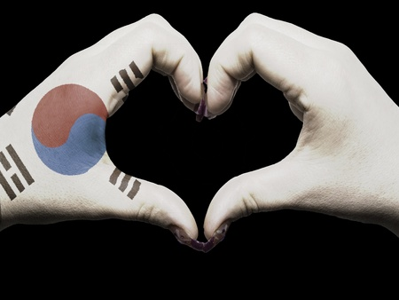 Tourist made gesture  by south korea flag colored hands showing symbol of heart and love