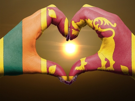 sri lankan flag: Tourist peru made by sri lanka flag colored hands showing symbol of heart and love during sunrise