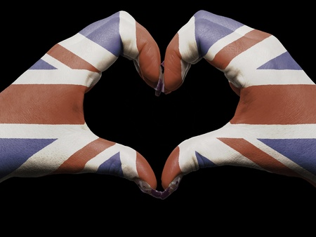 Gesture made by great britain flag colored hands showing symbol of heart and love  Stock Photo - 13208149