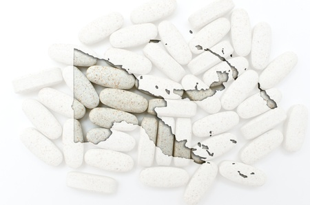 Outline papua new guinea map with transparent background of capsules symbolizing pharmacy and medicine