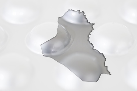 Outline iraq map with transparent background of capsules symbolizing pharmacy and medicine photo