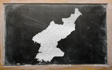 korean national: drawing of north korea on blackboard, drawn by chalk