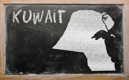 drawing of kuwait on blackboard, drawn by chalk Stock Photo - 12980666