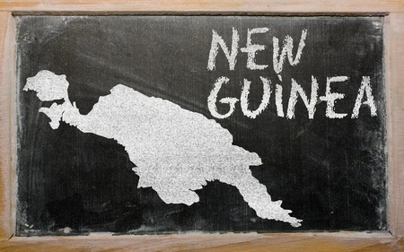 drawing of new guinea on blackboard, drawn by chalk Stock Photo - 12980657