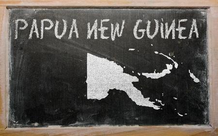 drawing of papua new guinea on blackboard, drawn by chalk Stock Photo - 12981275