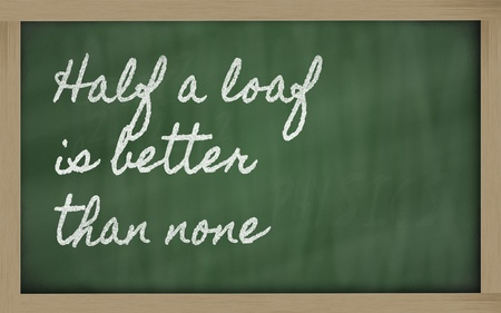 none: handwriting blackboard writings - Half a loaf is better than none Stock Photo
