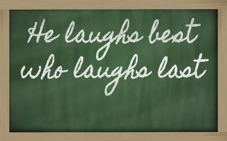 handwriting blackboard writings - He laughs best who laughs last Stock Photo - 12981429