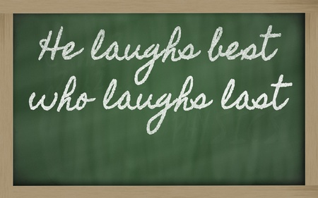 handwriting blackboard writings - He laughs best who laughs last Stock Photo - 12981429