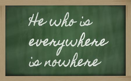 handwriting blackboard writings - He who is everywhere is nowhere Stock Photo - 12981418