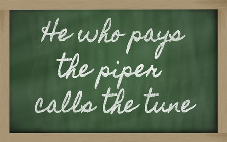 handwriting blackboard writings - He who pays the piper calls the tune Stock Photo - 12981400