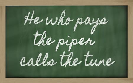 handwriting blackboard writings - He who pays the piper calls the tune Stock Photo - 12981400
