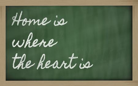 handschrift schoolbord geschriften - Thuis is waar het hart is Stockfoto