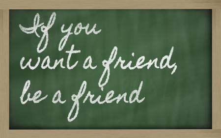 handwriting blackboard writings - If you want a friend, be a friend Фото со стока