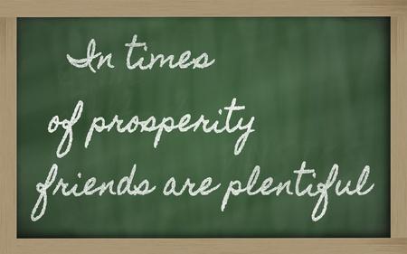 plentiful: handwriting blackboard writings - In times of prosperity friends are plentiful