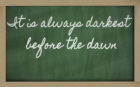 handwriting blackboard writings - It is always darkest before the dawn