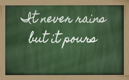 rains: handwriting blackboard writings - It never rains but it pours