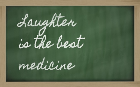 laughter: handwriting blackboard writings - Laughter is the best medicine Stock Photo