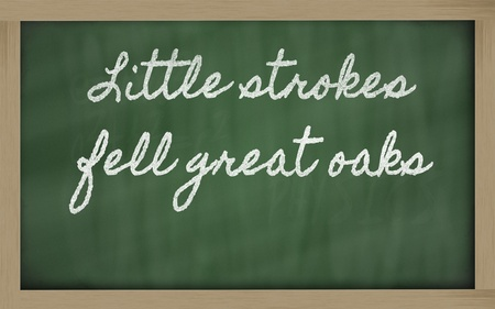 handwriting blackboard writings - Little strokes fell great oaks Stock Photo - 12981458