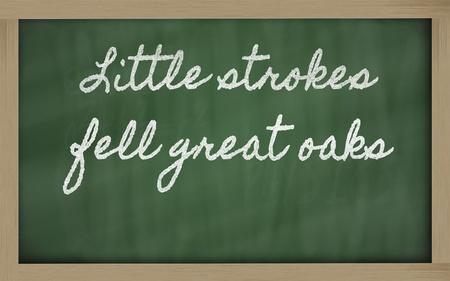 handwriting blackboard writings - Little strokes fell great oaks Stock Photo - 12981458
