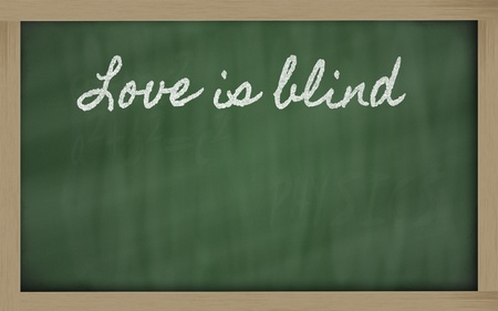 handwriting blackboard writings - Love is blind Stock Photo - 12981501