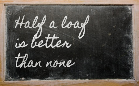 better: handwriting blackboard writings - Half a loaf is better than none Stock Photo