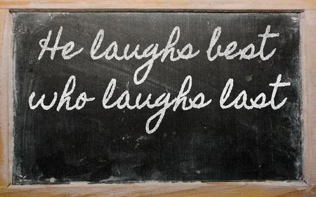 handwriting blackboard writings - He laughs best who laughs last Stock Photo - 12981305