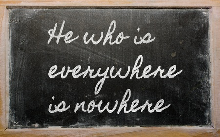 handwriting blackboard writings - He who is everywhere is nowhere Stock Photo - 12981258