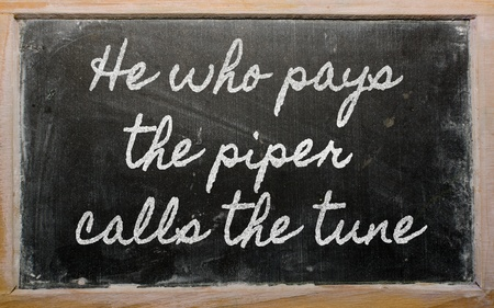 handwriting blackboard writings - He who pays the piper calls the tune Stock Photo - 12980656