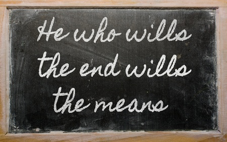 means to an end: handwriting blackboard writings - He who wills the end wills  the means Stock Photo