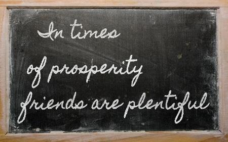 handwriting blackboard writings - In times of prosperity friends are plentiful