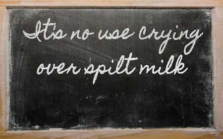 spilt: handwriting blackboard writings - Its no use crying over spilt milk Stock Photo