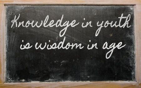 handwriting blackboard writings - Knowledge in youth is wisdom in age Stock Photo - 12981303