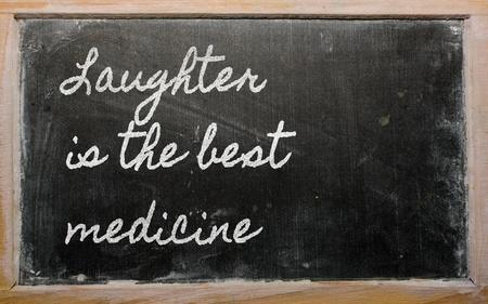 handwriting blackboard writings - Laughter is the best medicine Stock Photo