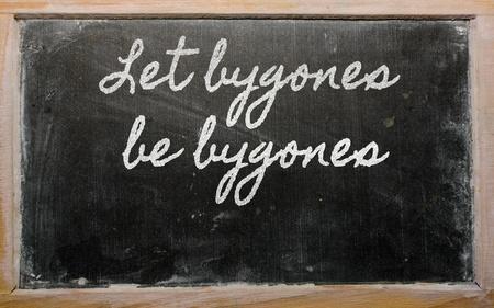 be: handwriting blackboard writings - Let bygones be bygones Stock Photo