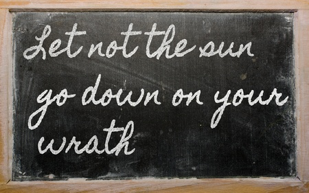 handwriting blackboard writings - Let not the sun go down on your wrath Фото со стока