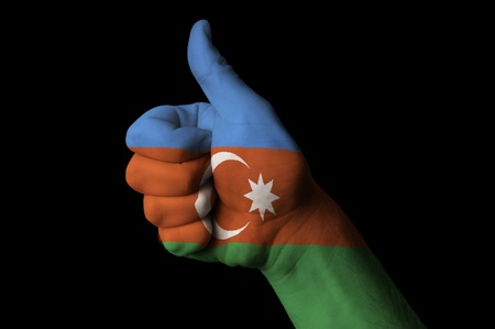azerbaijani: Hand with thumb up gesture in colored azerbaijan national flag as symbol of excellence, achievement, good, - useful for tourism and touristic advertising and also current positive political, cultural, social management of state or country