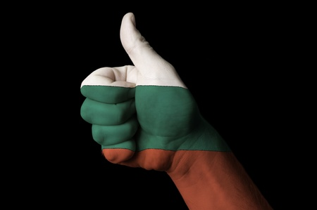 Hand with thumb up gesture colored in bulgaria national flag as symbol of excellence, achievement, good, - useful for tourism and touristic advertising and also current positive political, cultural, social management of state or country Stock Photo - 12980557