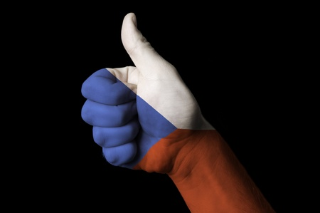 Hand with thumb up gesture colored in czech national flag as symbol of excellence, achievement, good, - useful for tourism and touristic advertising and also current positive political, cultural, social management of state or country Stock Photo - 12982107