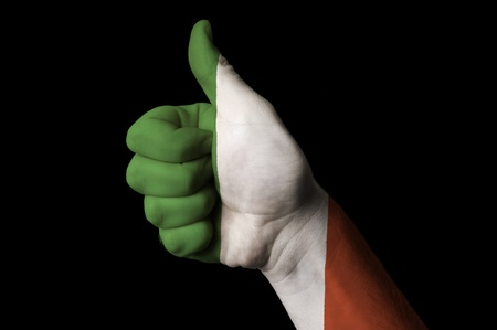 Hand with thumb up gesture in colored italy national flag as symbol of excellence, achievement, good, - useful for tourism and touristic advertising and also current positive political, cultural, social management of state or country Stok Fotoğraf