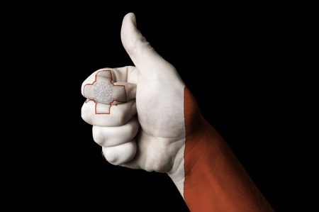 Hand with thumb up gesture in colored malta national flag as symbol of excellence, achievement, good, - useful for tourism and touristic advertising and also current positive political, cultural, social management of state or country Stok Fotoğraf