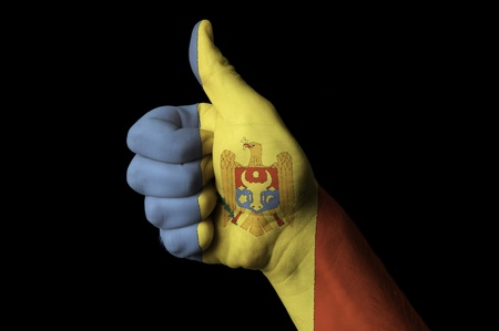 moldovan: Hand with thumb up gesture in colored moldova national flag as symbol of excellence, achievement, good, - useful for tourism and touristic advertising and also current positive political, cultural, social management of state or country Stock Photo