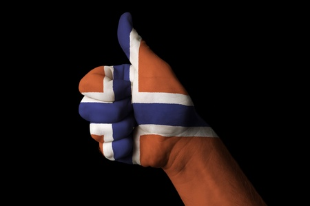Hand with thumb up gesture in colored norway national flag as symbol of excellence, achievement, good, - useful for tourism and touristic advertising and also current positive political, cultural, social management of state or country