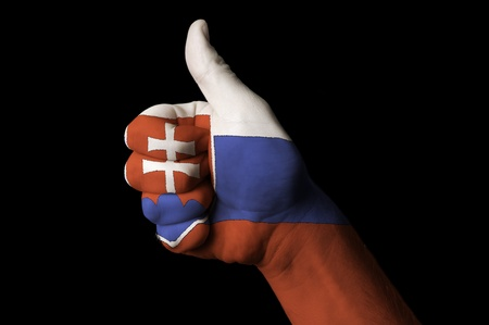 Hand with thumb up gesture in colored slovakia national flag as symbol of excellence, achievement, good, - useful for tourism and touristic advertising and also current positive political, cultural, social management of state or country Stok Fotoğraf