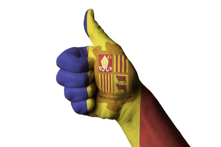 tourism in andorra: Hand with thumb up gesture colored in andorra national flag as symbol of excellence, achievement, good, - useful for tourism and touristic advertising and also current positive political, cultural, social management of state or country