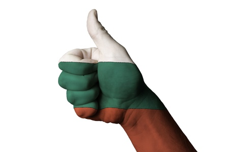 Hand with thumb up gesture colored in bulgaria national flag as symbol of excellence, achievement, good, - useful for tourism and touristic advertising and also current positive political, cultural, social management of state or country