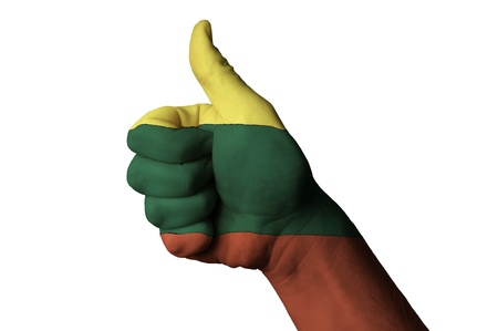 Hand with thumb up gesture in colored lithuania national flag as symbol of excellence, achievement, good, - useful for tourism and touristic advertising and also current positive political, cultural, social management of state or country Stok Fotoğraf