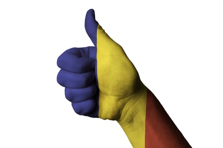 Hand with thumb up gesture in colored romania national flag as symbol of excellence, achievement, good, - useful for tourism and touristic advertising and also current positive political, cultural, social management of state or country photo